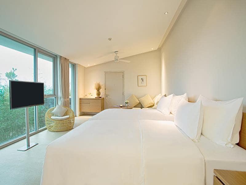 Phòng ngủ tuyệt vời tại Villa 2 phòng ngủ Naman Retreat